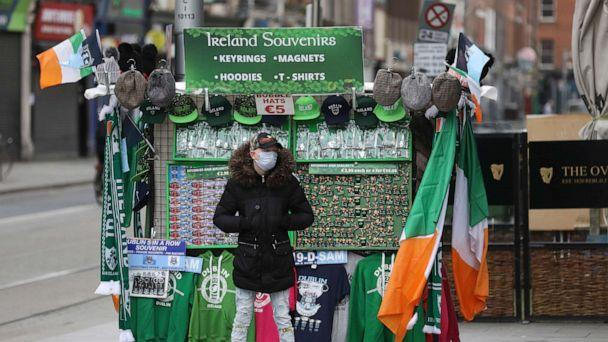 PHOTO: A souvenir seller waits for business in Dublin, March 17, 2020. The St Patrick's Day parades across Ireland were cancelled due to the outbreak of coronavirus. (Peter Morrison/AP)