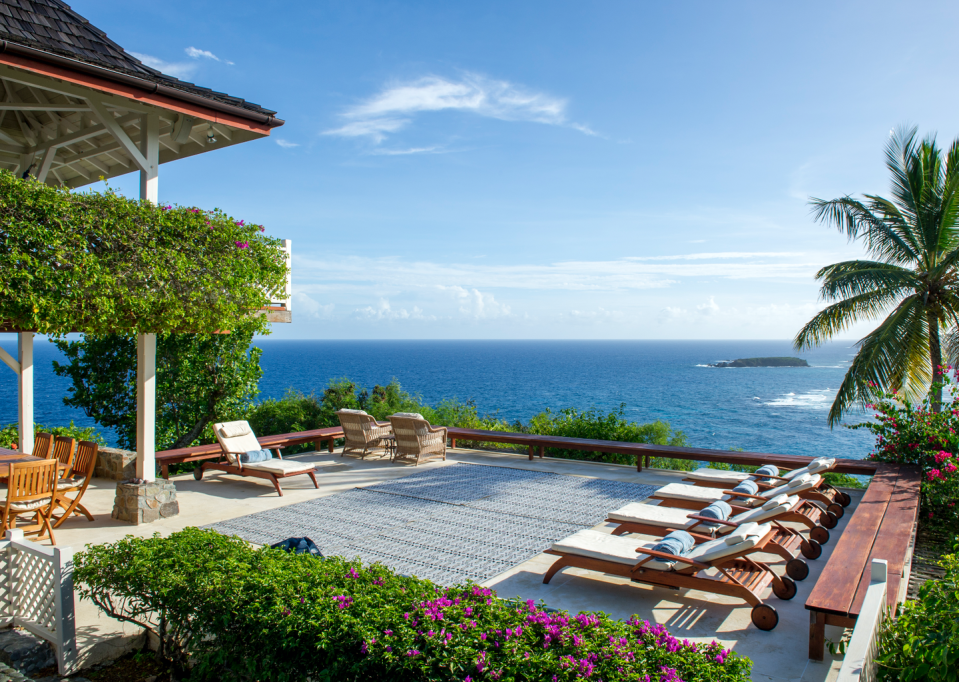 """<p>It's no surprise that Mustique makes the list for the world's best views, but Pangolin is the very best of the best with unparalleled lookouts. Built high above the beaches, you have sweeping panoramic visual access to the stunning landscape–and the best breezes too. </p><p>The largest estate on Mustique in terms of acreage, Pangolin is a fully staffed, exceptionally luxurious villa that just underwent an incredible renovation–and offers the utmost in privacy and service. You won't miss out on visiting the fabulous <a href=""""http://www.cottonhouse.net/"""" rel=""""nofollow noopener"""" target=""""_blank"""" data-ylk=""""slk:Cotton House"""" class=""""link rapid-noclick-resp"""">Cotton House</a>, as any guests at Pangolin have access to the beach club there, a truly world class property, beach and view in its own right.</p>"""