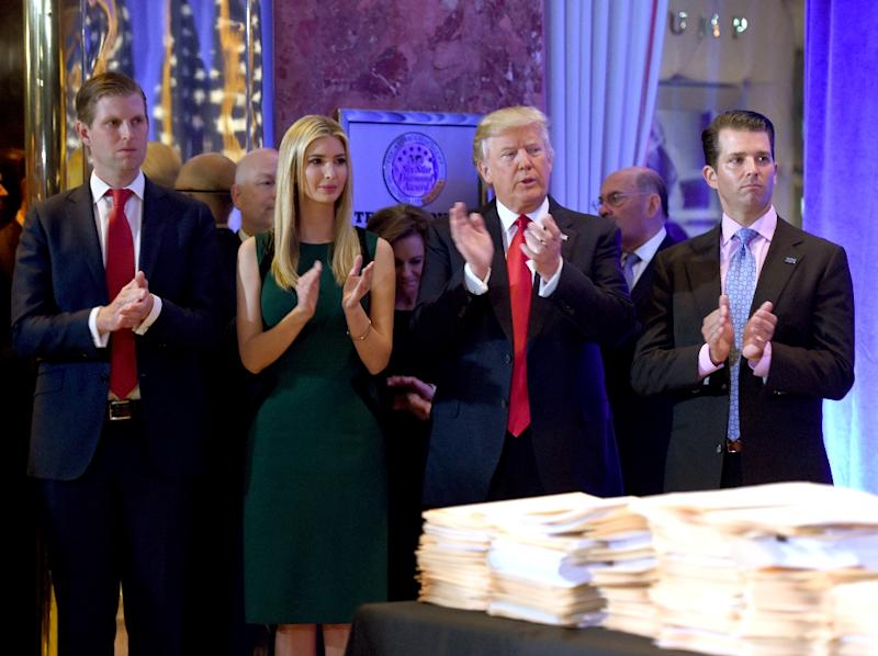 US President-elect Donald Trump along with his children (L-R) Eric, Ivanka and Donald Jr. arrive for a press conference on January 11, 2017 at Trump Tower in New York (AFP Photo/Timothy A. CLARY                  )
