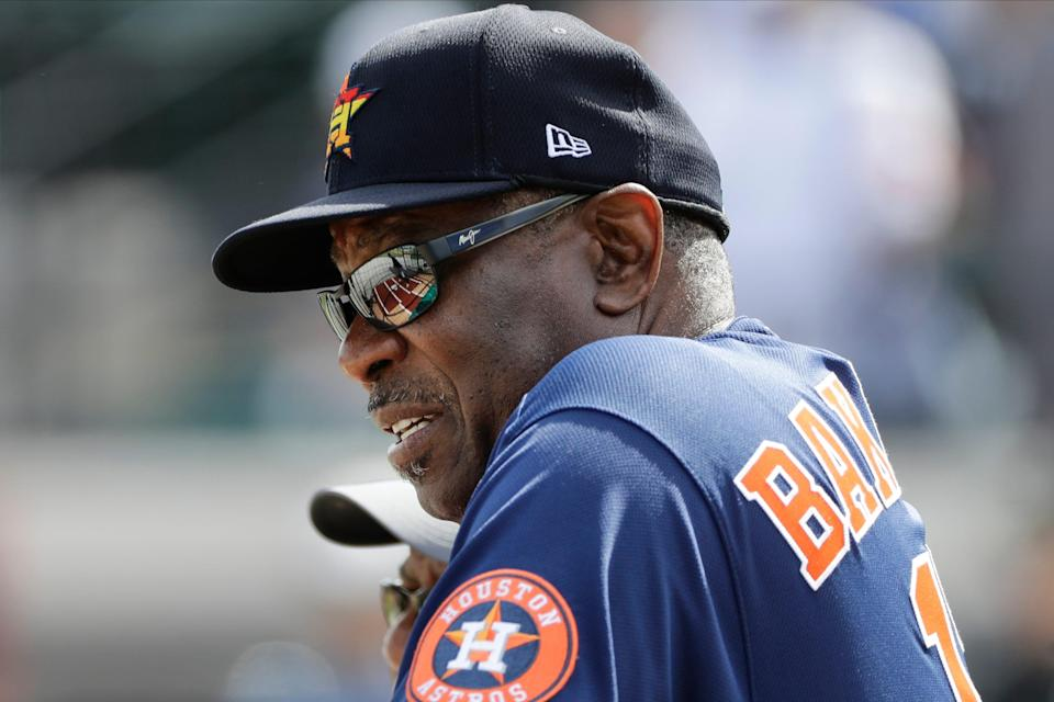 Houston Astros manager Dusty Baker watches batting practice before a spring training baseball game against the Detroit Tigers on Monday, Feb. 24, 2020, in Lakeland, Fla.