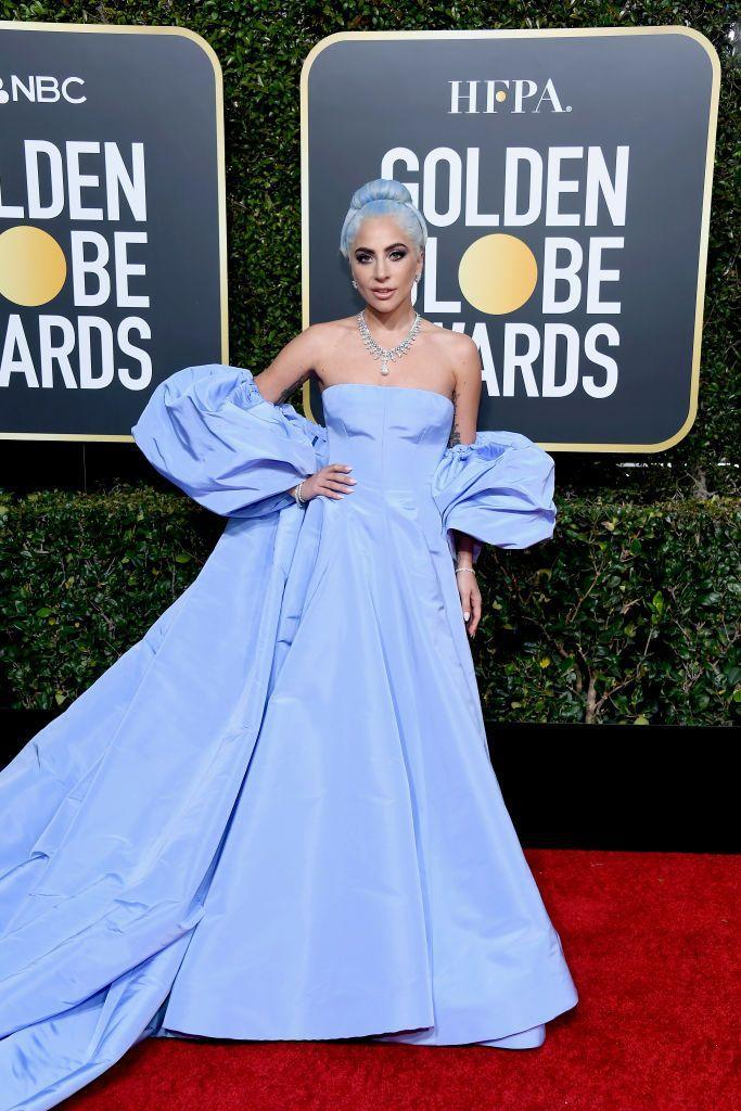 """<p>Gaga broke the internet in a <a href=""""https://www.elle.com/uk/fashion/celebrity-style/a25766831/lady-gaga-may-have-just-won-the-golden-globes-2019-red-carpet-in-a-blue-gownwith-matching-hair/"""" rel=""""nofollow noopener"""" target=""""_blank"""" data-ylk=""""slk:periwinkle blue couture Valentino gown worn as an homage to her A Star Is Born fore-bearer Judy Garland"""" class=""""link rapid-noclick-resp"""">periwinkle blue couture Valentino gown worn as an homage to her A Star Is Born fore-bearer Judy Garland</a>.</p>"""