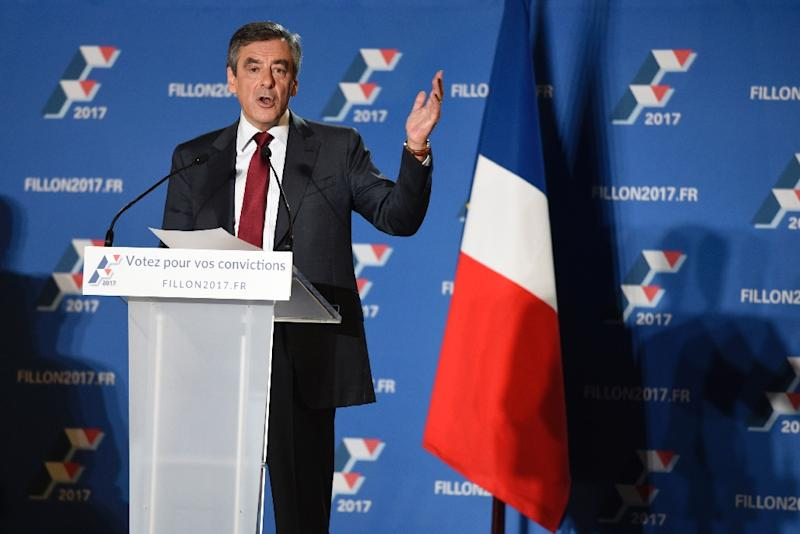 Candidate for France's right-wing Les Republicains (LR) party primaries for the 2017 presidential election, Francois Fillon, delivers a speech during a meeting in Chassieu, southwestern France on November 22, 2016