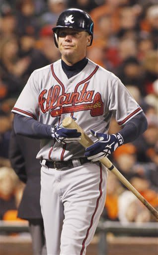 Atlanta Braves' Chipper Jones walks back to the dugout after striking out against the San Francisco Giants during the seventh inning of a baseball game in San Francisco, Friday, Aug. 24, 2012. (AP Photo/George Nikitin)