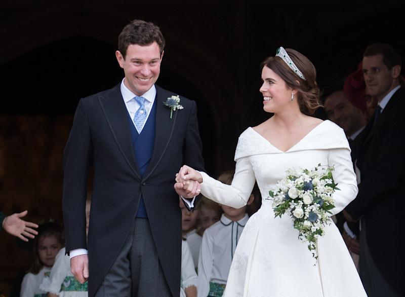 WINDSOR, ENGLAND - OCTOBER 12: Princess Eugenie of York and Jack Brooksbank leave St George's Chapel in Windsor Castle following their wedding at St. George's Chapel on October 12, 2018 in Windsor, England. (Photo by Pool/Samir Hussein/WireImage)