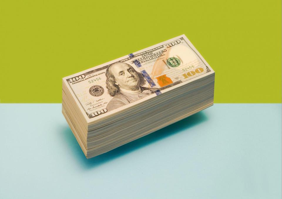 An image of a floating stack of $100 bills.