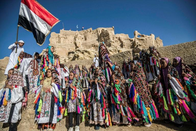 Egyptian schoolchildren are seen wearing traditional outfits for the inauguration of the renovated fortress on November 6