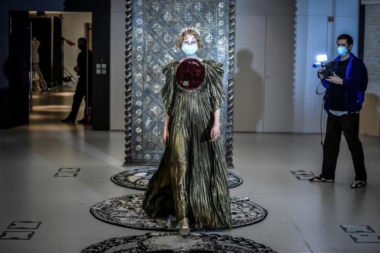 A model presents a creation by Christian Dior during a fitting session at Christian Dior's Haute Couture fashion house in Paris on January 20, 2021