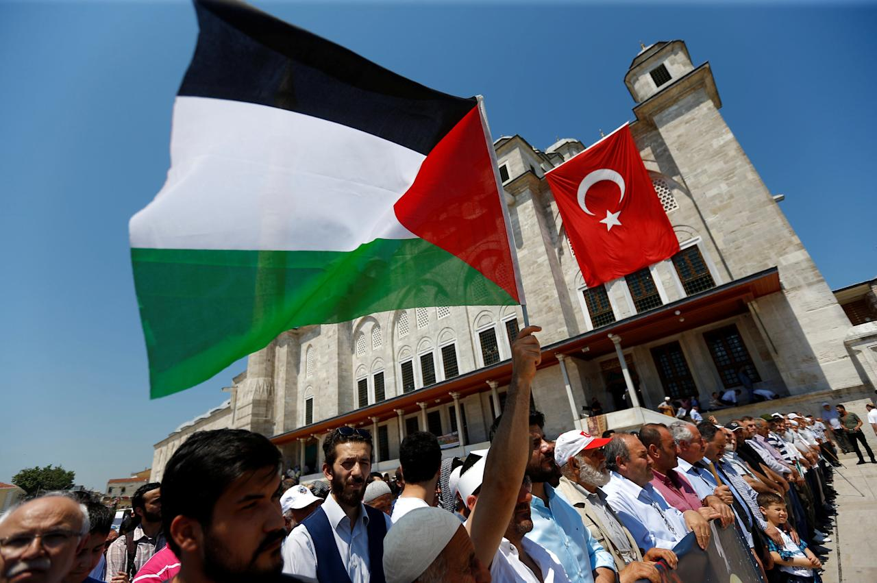 Demonstrators take part in a protest marking the annual al-Quds Day, or Jerusalem Day, at the courtyard of Fatih mosque in Istanbul, Turkey June 23, 2017. REUTERS/Murad Sezer