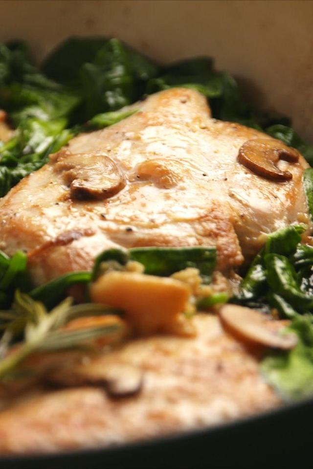 """<p>Roasting the garlic beforehand makes all the difference.</p><p>Get the recipe from <a href=""""https://www.delish.com/cooking/recipe-ideas/recipes/a55097/garlic-rosemary-chicken-recipe/"""" rel=""""nofollow noopener"""" target=""""_blank"""" data-ylk=""""slk:Delish"""" class=""""link rapid-noclick-resp"""">Delish</a>.</p>"""