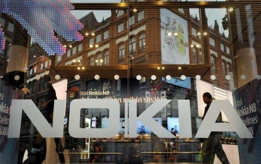 Nokia posts fourth quarter profit, waives dividend