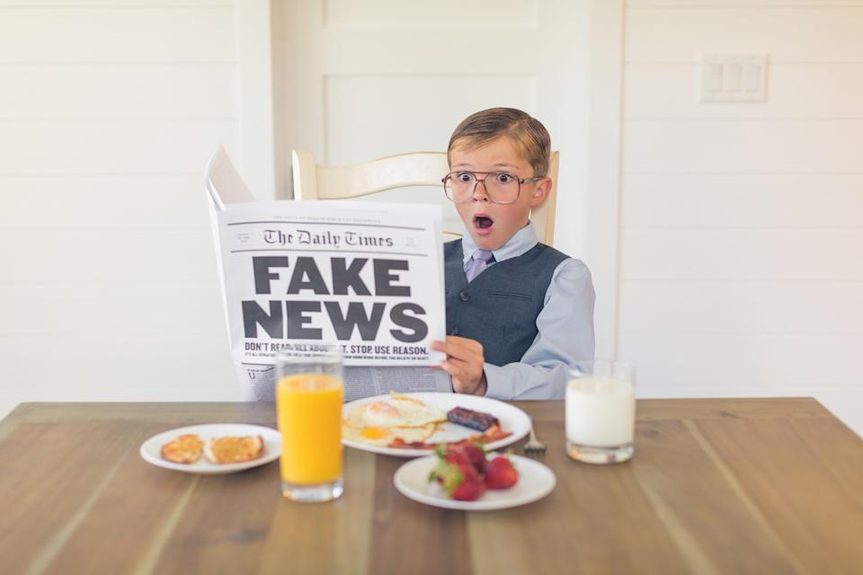 Young man reads fake news. Source: Getty