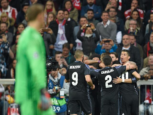 Cristiano Ronaldo celebrates his winning first leg goal at the Allianz Arena: Getty