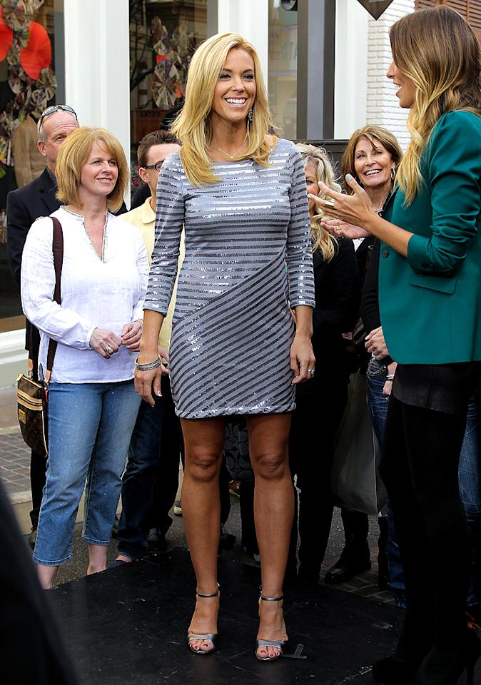 "A very tan and blond Kate Gosselin stopped by the ""Extra"" set at The Grove (an outdoor shopping mall in L.A.) on Thursday. The mom of eight and former reality star is still trying to hawk tickets to the scary-sounding Kate Gosselin cruise. Would you want to spend your vacay with Kate? (01/19/2012)"