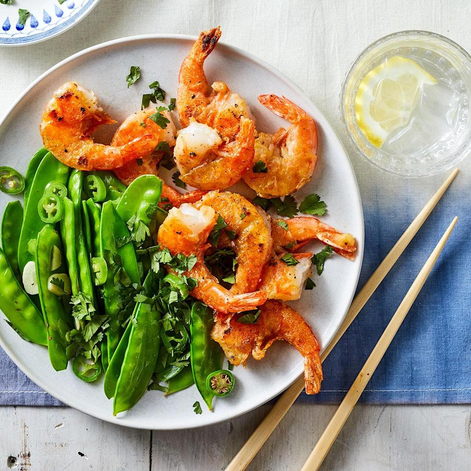 """<p>In China, salt and pepper shrimp is traditionally made with tongue-numbing Sichuan peppercorns. If you have some in the pantry, feel free to use them here; we opted for a combo of easier-to-find white and black pepper. The white pepper adds earthy flavor, while black kicks up the heat.</p> <p> <a href=""""http://www.eatingwell.com/recipe/280008/salt-pepper-shrimp-with-snow-peas/"""" rel=""""nofollow noopener"""" target=""""_blank"""" data-ylk=""""slk:View recipe"""" class=""""link rapid-noclick-resp""""> View recipe </a></p>"""