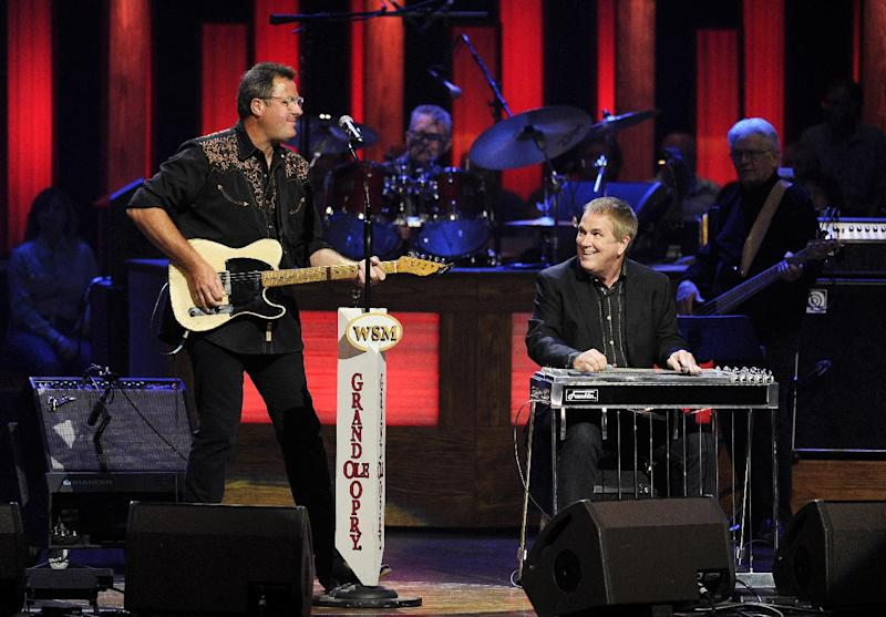 """This Saturday, July 27, 2013 photo shows Vince Gill, left, and Paul Franklin performing at the Grand Ole Opry in Nashville, Tenn. Gill and Franklin released their latest album """"Bakersfield,"""" on July 30. (Photo by Donn Jones/Invision/AP)"""