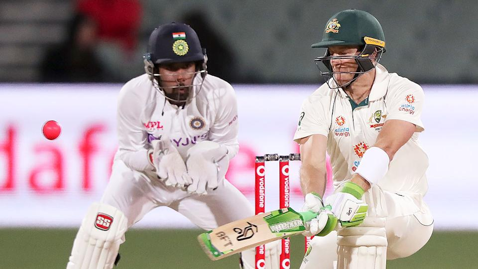 Seen here, Tim Paine plays a shot against India on day two of the first Test in Adelaide.
