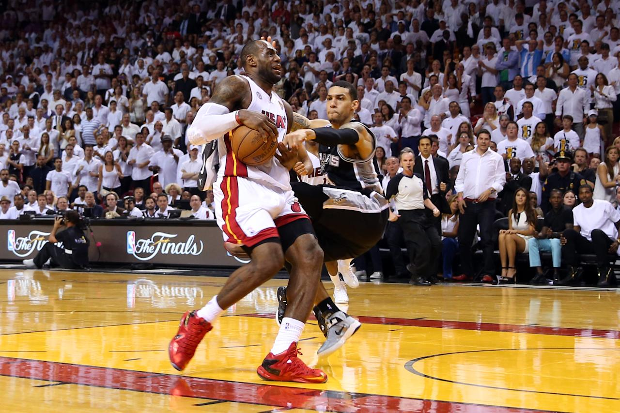 MIAMI, FL - JUNE 18: LeBron James #6 of the Miami Heat goes up for a shot against Danny Green #4 of the San Antonio Spurs in overtime during Game Six of the 2013 NBA Finals at AmericanAirlines Arena on June 18, 2013 in Miami, Florida. NOTE TO USER: User expressly acknowledges and agrees that, by downloading and or using this photograph, User is consenting to the terms and conditions of the Getty Images License Agreement. (Photo by Mike Ehrmann/Getty Images)