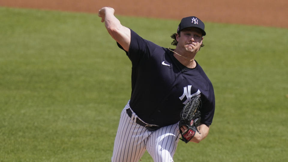 New York Yankees starting pitcher Gerrit Cole delivers a pitch during the first inning of a spring baseball game against the Detroit Tigers Monday, March 1, 2021, in Tampa, Fla. (AP Photo/Frank Franklin II)