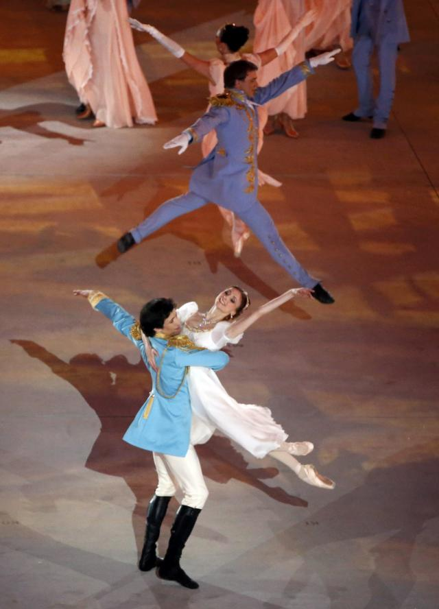 Ballet dancers Ivan Vasiliev and Svetlana Zakharova (bottom) take part in during the opening ceremony of the 2014 Sochi Winter Olympics, February 7, 2014. REUTERS/Lucy Nicholson (RUSSIA - Tags: OLYMPICS SPORT)