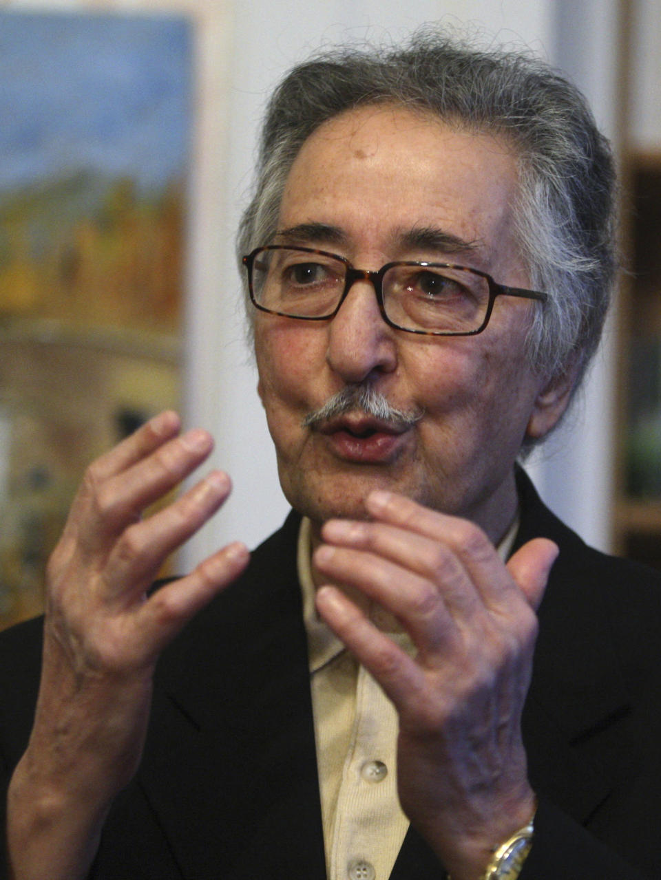 FILE — In this Dec. 30, 2009, file photo, former Iranian President Abolhassan Banisadr, gestures as he speaks during an interview with the Associated Press in Versailles, west of Paris, France. Banisadr, Iran's first president after the country's 1979 Islamic Revolution who fled Tehran after being impeached for challenging the growing power of clerics as the nation became a theocracy, died Saturday, Oct. 9. 2021. He was 88. (AP Photo/Michel Euler, File)
