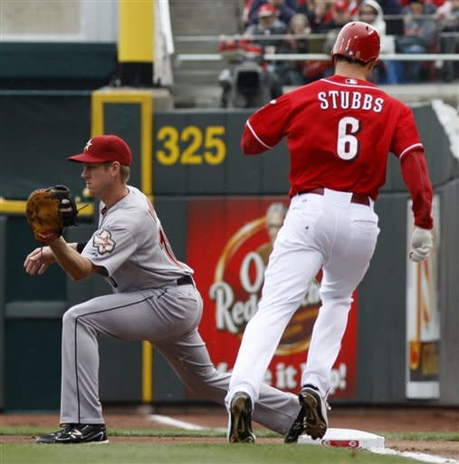 Cincinnati Reds' Drew Stubbs (6) is out at first after a ground ball hit off Houston Astros starting pitcher Lucas Harrell during the first inning of a baseball game on Saturday, April 28, 2012, in Cincinnati. Astros first baseman Matt Downs, left, completes the play. (AP Photo/David Kohl)