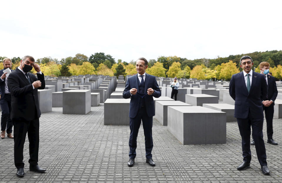 German Foreign Minister Heiko Maas, center, visits with his counterparts from Israel Gabi Ashkenazi, left, and the United Arab Emirates Sheikh Abdullah bin Zayed Al Nahyan the Holocaust Memorial during a meeting in Berlin, Germany, Tuesday, Oct. 6, 2020. The three foreign minister meet for talks in the German capital. (Michele Tantussi/Pool via AP)