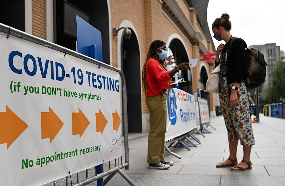 A COVID testing centre in London. Vaccinated people who are sneezing can order a test through the ZOE app. (EPA)