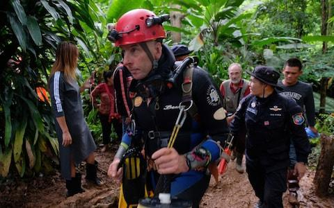 <span>British cave-diver Richard William Stanton walks out from Tham Luang Nang Non cave in full kit w</span> <span>Credit: Getty </span>