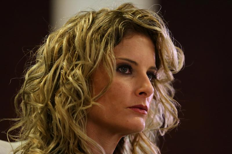 """Summer Zervos, a former contestant on """"The Apprentice,"""" is suing President Donald Trump for defamation after he denied groping her without consent. (Mike Blake / Reuters)"""