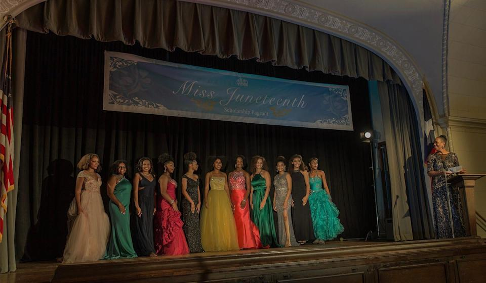 """Kai (Alexis Chikaeze) takes the stage at the beauty pageant in """"Miss Juneteenth."""""""