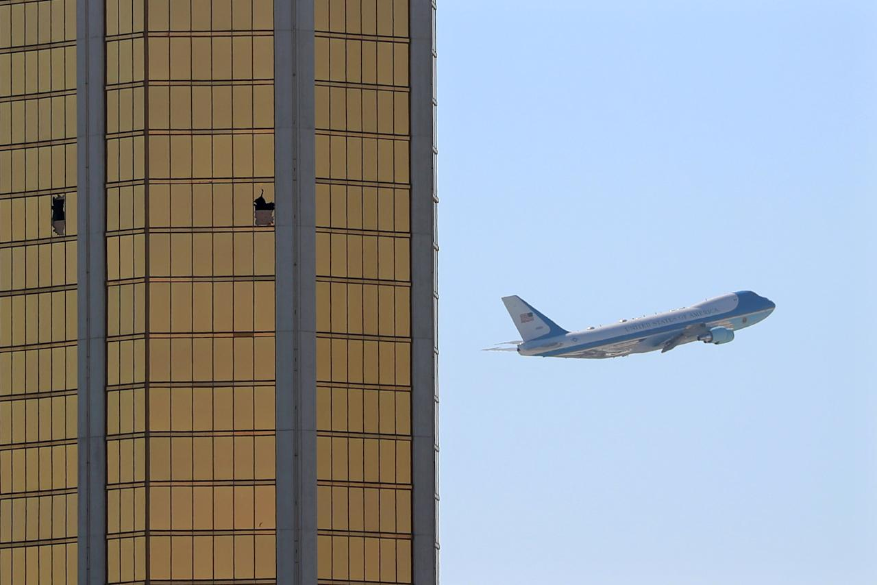 "Air Force One departs Las Vegas past the broken windows on the Mandalay Bay hotel, where shooter Stephen Paddock conducted his mass shooting along the Las Vegas Strip in Las Vegas, Nevada, U.S., October 4, 2017. Mike Blake: ""This all started with a phone call in the middle of the night. A mass shooting in Las Vegas. I packed my gear and left my house in southern California in the dark. Arriving with other colleagues at first light, I began covering what was to become the worst mass shooting in modern U.S. history. The picture of the president's plane leaving Las Vegas was planned and thought out. I had watched 737 aircraft take off from my hotel window and thought that because Air Force One is a much larger and heavier plane than most others, it might fly just above the hotel where the shooter had smashed out hotel windows to commit his crime. We had a rough schedule of the president's timeline, as we have a photographer travelling on his plane. But after patiently waiting for it to come into my viewfinder I put my camera down and texted our travelling photographer. They were obviously running late and he texted back they were just arriving back at the airport. When the plane came into my viewfinder I was shocked by how low it was. I expected it to be just above the hotel but it was really low and passed behind the hotel. I quickly refocused and reframed and waited for the plane to reappear on the side where the broken windows were. I shot about 15 frames and did a quick edit and filed to our global picture desk in Singapore. The whole thing took about five minutes. When the president's plane landed hours later in Washington, I received a text from our travelling photographer Kevin Lamarque saying a White House press person loved the image and had come to show him the picture on the flight home."" REUTERS/Mike Blake/File photo SEARCH ""POY STORY"" FOR THIS STORY. SEARCH ""REUTERS POY"" FOR ALL BEST OF 2017 PACKAGES. TPX IMAGES OF THE DAY."