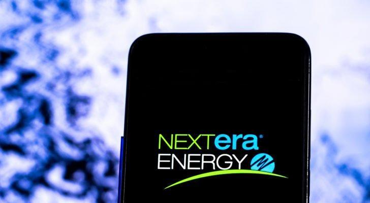 The NextEra Energy (NEE) logo is displayed on a smartphone screen.