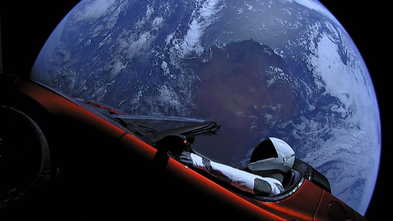 "IN SPACE - FEBRUARY 8: In this handout photo provided by SpaceX, a Tesla roadster launched from the Falcon Heavy rocket with a dummy driver named ""Starman"" heads towards Mars. (Photo by SpaceX via Getty Images)"