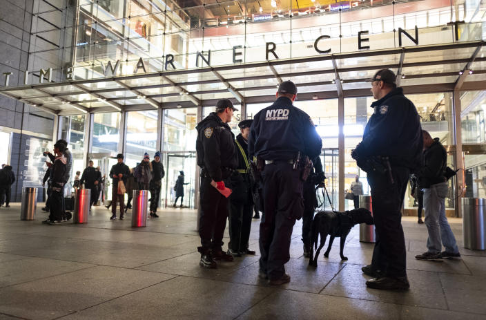 <p>New York City police officers stand by the scene after a report of a possible suspicious package was called in at the Time Warner Center Thursday, Oct. 25, 2018, in New York. Normal activity resumed at the building shortly after police cleared the scene. (Photo: Craig Ruttle/AP) </p>