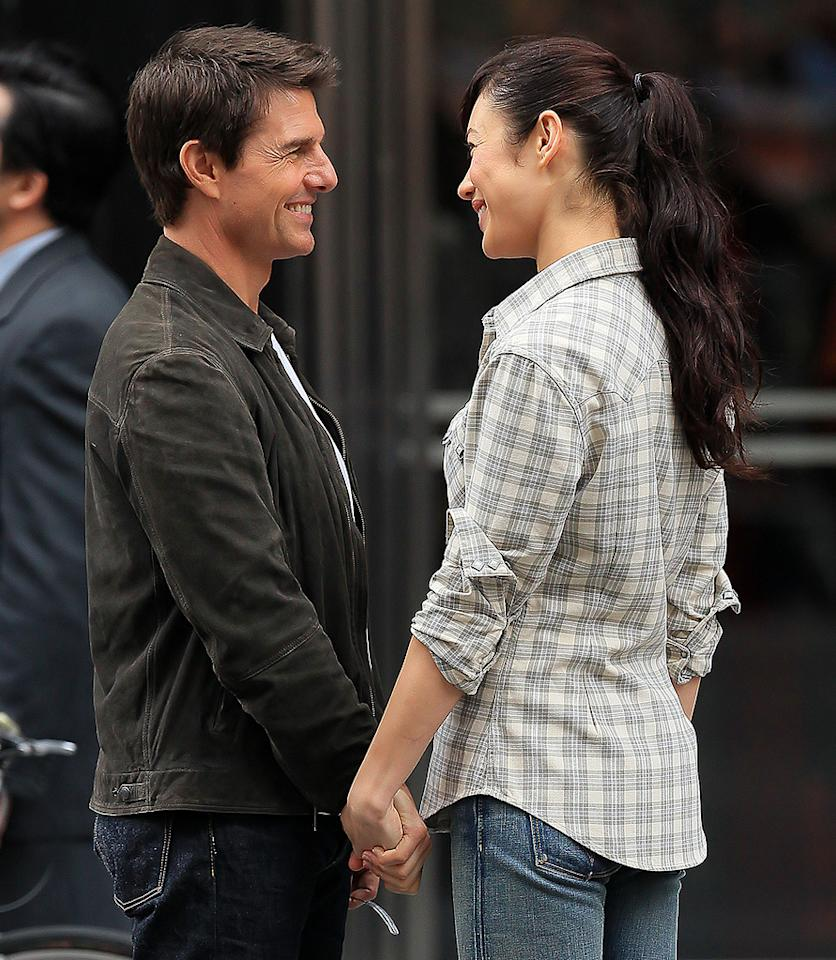 "<p class=""MsoPlainText"">Tom Cruise was caught getting cozy with ""Oblivion"" costar Olga Kurylenko, reports MediaTakeOut, which adds that ""Katie Holmes better come get her man."" The site says Cruise and Kurylenko were spotted holding hands and looking smitten ""when the cameras were off."" For what's going on between them, and how concerned Holmes should be, see what a Cruise insider reveals to <a target=""_blank"" href=""http://www.gossipcop.com/tom-cruise-olga-kurylenko-cheating-katie-holmes-oblivion-costar/"">Gossip Cop</a>.</p>"