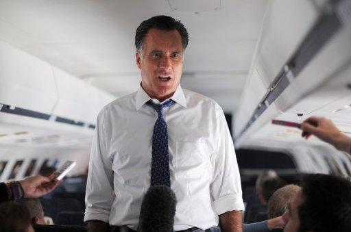 <p>US Republican presidential candidate Mitt Romney talks to journalists on board his campaign plane, on September 28. With 39 days to go for the election and polls showing an narrowing path to victory for the Republican nominee, Romney warned a second Obama term would be 'subsumed by economic malaise.'</p>