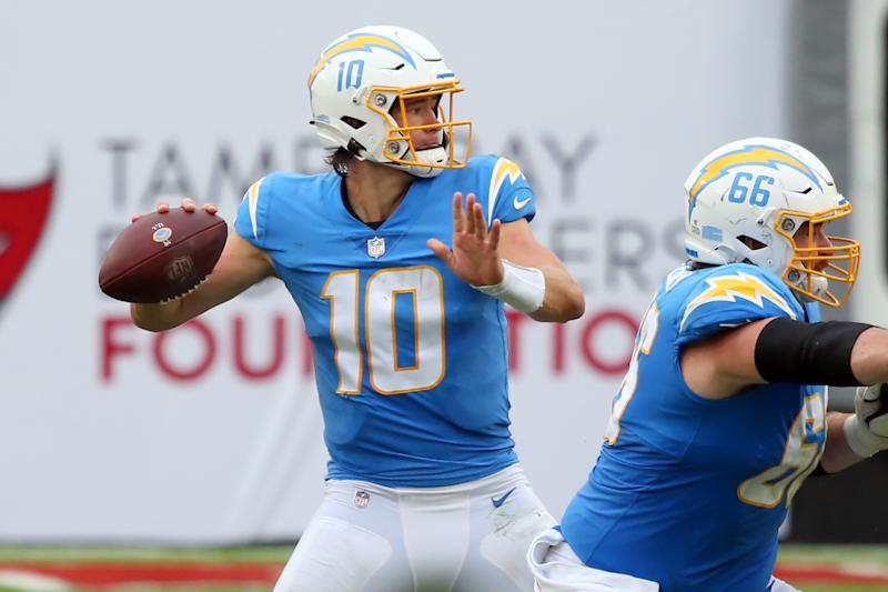 TAMPA, FL - OCTOBER 04: Justin Herbert (10) of the Chargers looks to throw a pass to his left side during the regular season game between the Los Angeles Chargers and the Tampa Bay Buccaneers on October 04, 2020 at Raymond James Stadium in Tampa, Florida. (Photo by Cliff Welch/Icon Sportswire via Getty Images)