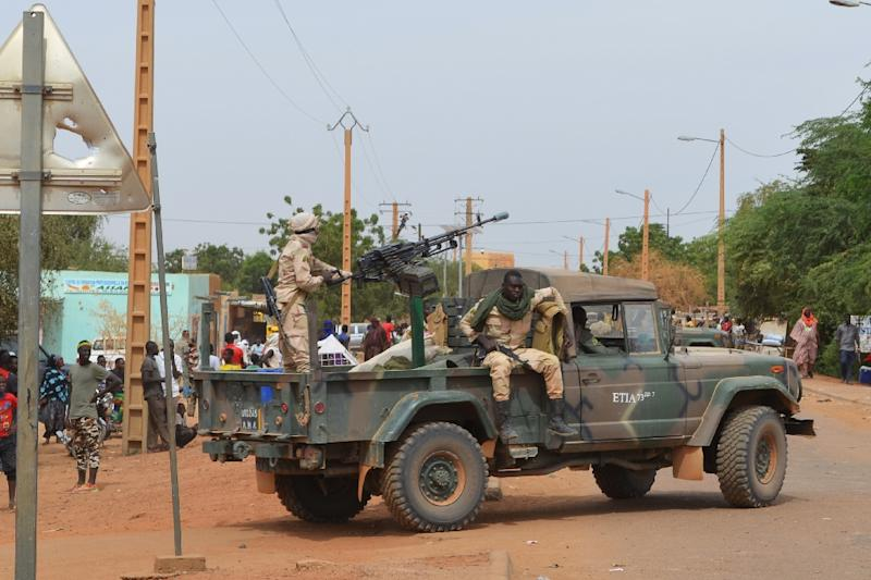 Malian soldiers on patrol in the city of Gao after a deadly suicide car bomb detonated in November 2018