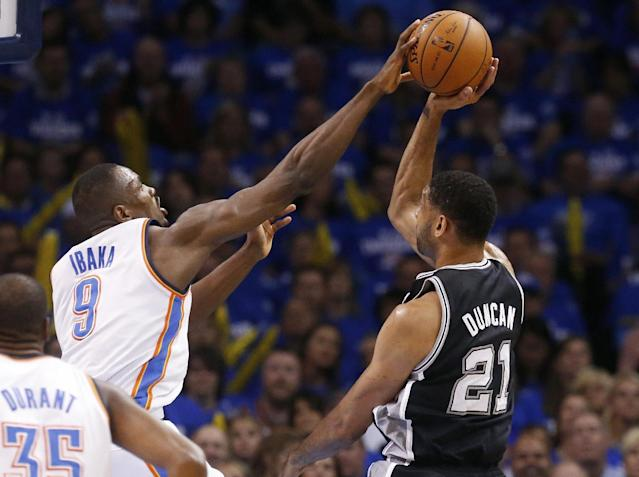 Oklahoma City Thunder forward Serge Ibaka (9) blocks a shot by San Antonio Spurs forward Tim Duncan (21) in the first quarter of Game 4 of the Western Conference finals NBA basketball playoff series in Oklahoma City, Tuesday, May 27, 2014. (AP Photo/Sue Ogrocki)