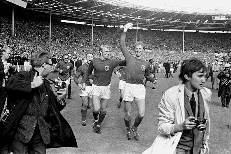 File photo dated 30-07-1966 of England's Jack Charlton (r) holds the Jules Rimet trophy aloft as he parades it around Wembley with teammates Ray Wilson (l), George Cohen (second l) and Bobby Moore (second r) following their 4-2 win.