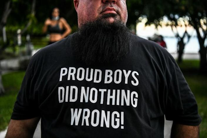 A Trump supporter wears a Proud Boys shirt prior to the president's arrival for an NBC News town hall in Miami on October 15, 2020