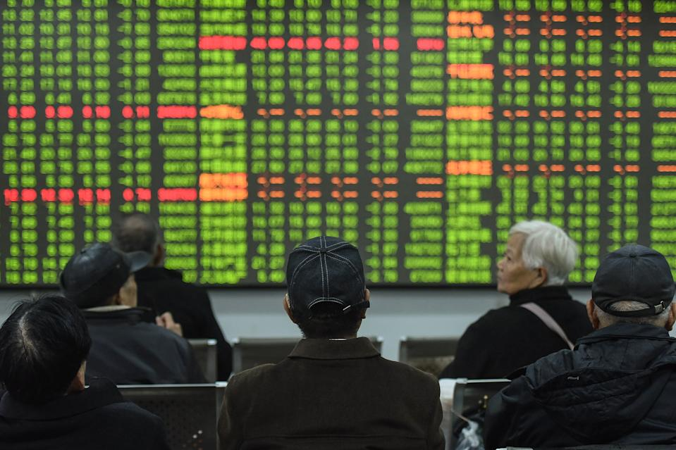 Investors look at a screen showing stock market movements at a securities company in Hangzhou in China's eastern Zhejiang province on February 3, 2020. - Chinese stocks crashed on February 3 with some major shares quickly falling by the maximum daily limit as the country's investors got their first chance in more than a week to react to the spiralling coronavirus outbreak. (Photo by STR / AFP) / China OUT (Photo by STR/AFP via Getty Images)