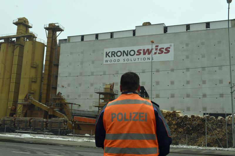 "A police stands in front of a wood-processing company in Menznau, central Switzerland, Wednesday, Feb. 27, 2013, where several people were killed in a shooting. Police in Lucerne canton (state) said in a statement that the shooting occurred shortly after 9 a.m. at the premises of Kronospan, a company in the small town west of Lucerne. They said there were ""several dead and several seriously injured people"" and that rescue services were deployed and the scene sealed off. (AP Photo/Keystone, Urs Flueeler)"