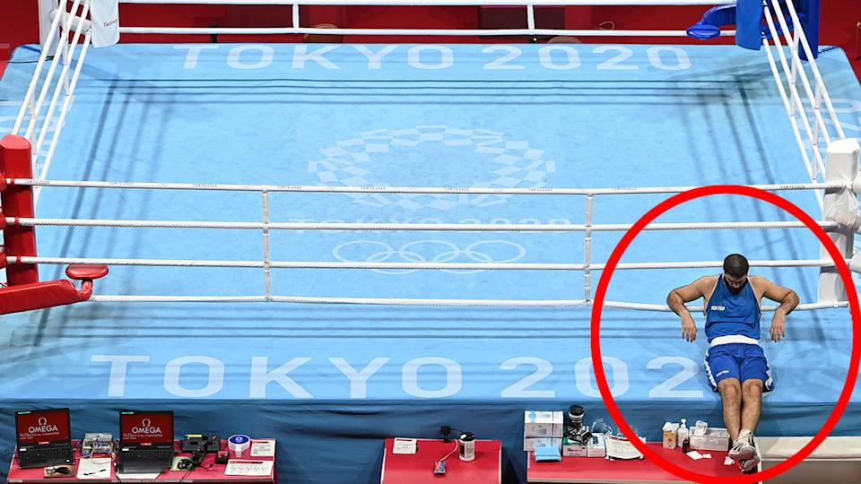 Pictured here, Frenchman Mourad Aliev stages a sit-in protest after his disqualification in the Olympic boxing.