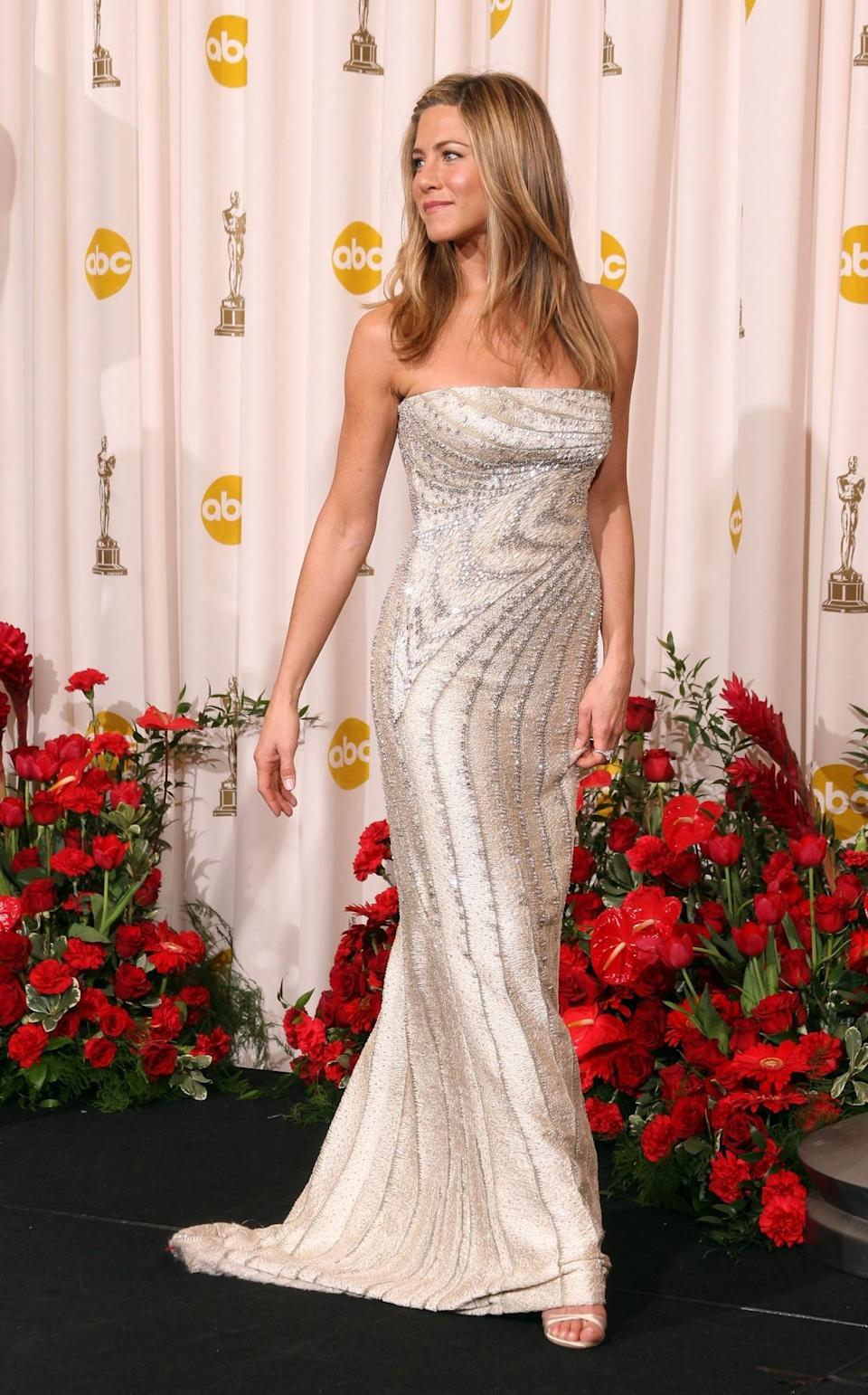 <p>Jennifer's sequin-encrusted Valentino gown was one of the style highlights of the 2009 Oscars. <i>[Photo: Getty]</i> </p>