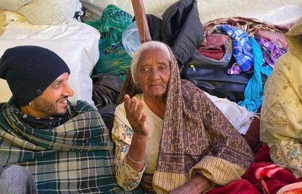 Bains is seen with an agricultural worker during his visit to India in late 2020.