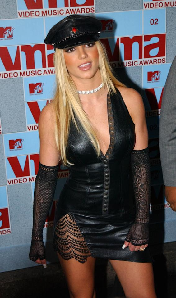 Way before Rihanna started singing about S&M, Britney was rocking the leather look. Here she went all out in a dress, sexy tights and a flat cap.