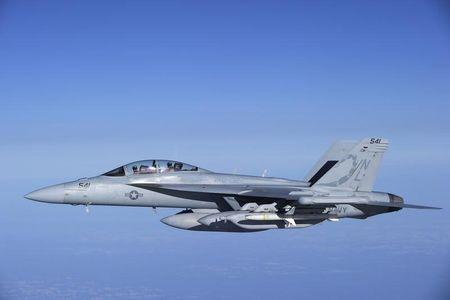 """A U.S. Navy EA-18G Growler carrier-based electronic warfare jet from the Electronic Attack Squadron """"Scorpions"""" flies over the Mediterranean Sea near Trapani"""