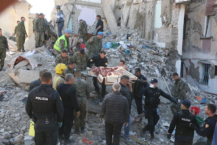 Soldiers carry a dead body pulled out from debris after 6.4-magnitude earthquake hit Albania's Durres city on November 26, 2019. (Photo: Olsi Shehu/Anadolu Agency via Getty Images)