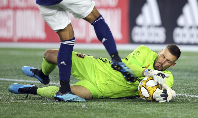 Real Salt Lake goalkeeper Andrew Putna (51) makes a save on a shot by New England Revolution forward Teal Bunbury, left, during the second half of an MLS soccer match at Gillette Stadium, Saturday, Sept. 21, 2019, in Foxborough, Mass. (AP Photo/Stew Milne)